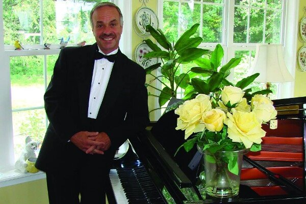 "Phil Perdue – ""The Piano Man"""